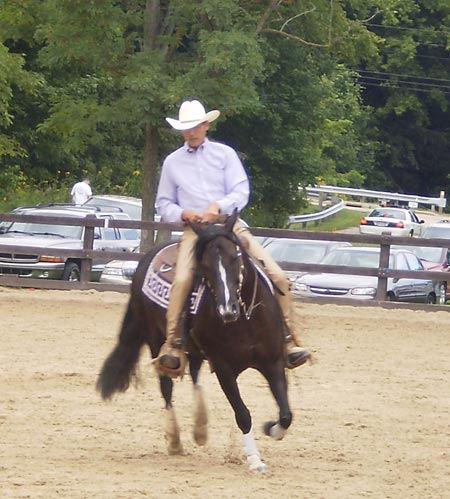 Ron Kohlhoff gives a reining demonstration on Guntown's Little Angel, a regular paint mare, owned by Terri Bayless.