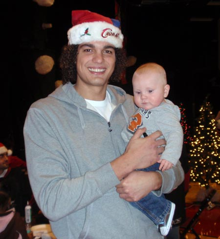 Cleveland Cavs Anderson Varejao with a tiny fan