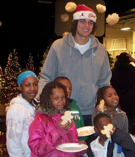 Cleveland Cavaliers Anderson Varejao with young fans