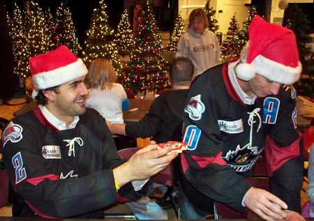 Lake Erie Monsters hockey players Wes O'Neill and Darren Haydar help kids make Christmas cookies