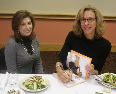 Joan Pagano signs her book