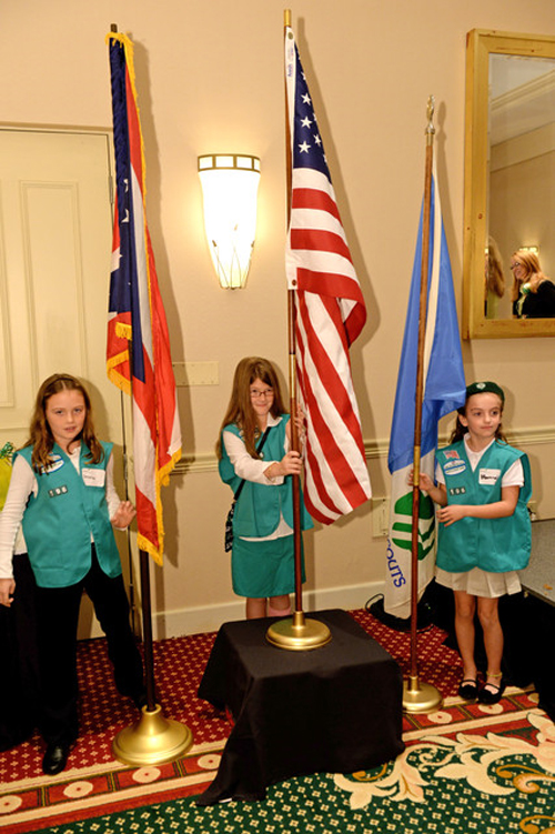 Gilr Scouts with flags