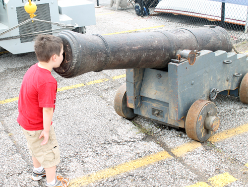 Boy looking into Cannon at Tall Ships Festival in Cleveland