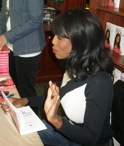Omarosa from Donald Trump The Apprentice signing Bitch Switch book