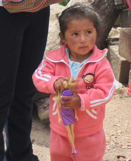 Peruvian girl with doll