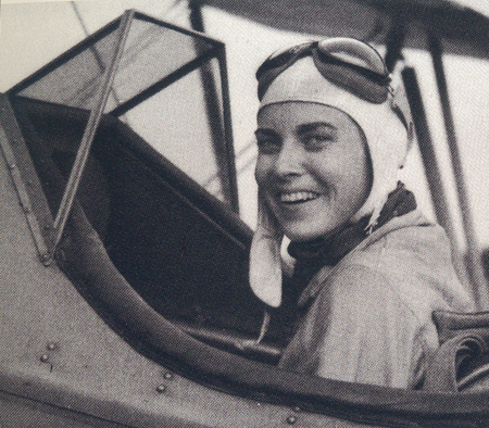 Ann Halle in the cockpit of a plane