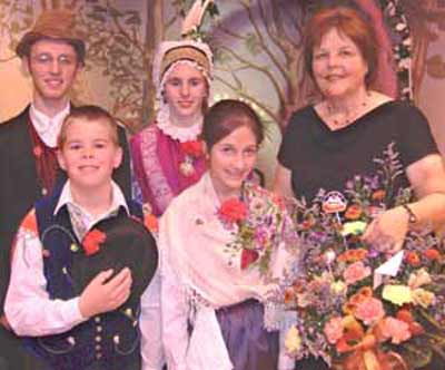 Cecilia Dolgan and children in traditional Slovenian costumes