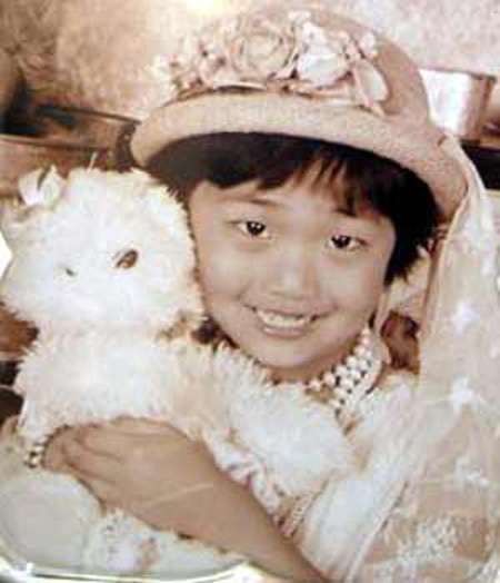 Young Demi Zhang with bear