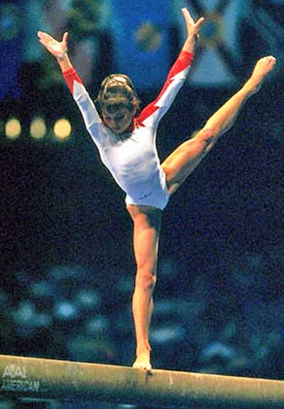 Young Gymnast Dominique Moceanu on the balance beam