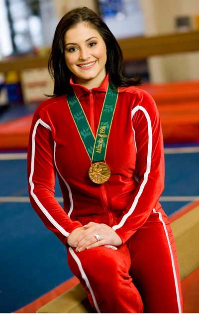 Dominique Moceanu with Olympic Gold Medal