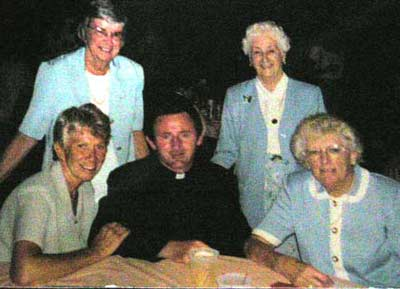 Helen Bacon with Father Devine and friends