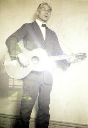 Helga's father Carl Sandburg with guitar