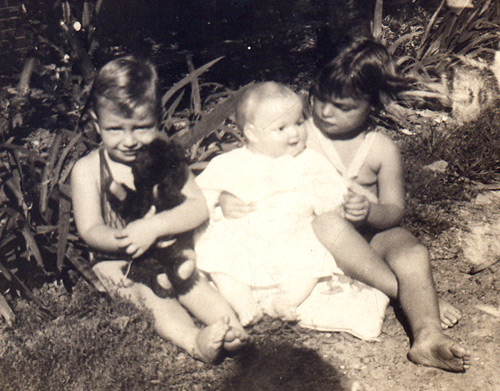 Jenny Gecsy (Brown) at age 3 in 1930 with her brother Bob, age 1, and a favorite toy