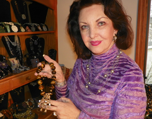 Maria Pujana at home with some of her jewelry designs