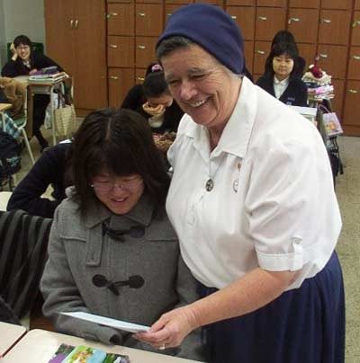 Sister Ann Patrick teaching a Korean girl