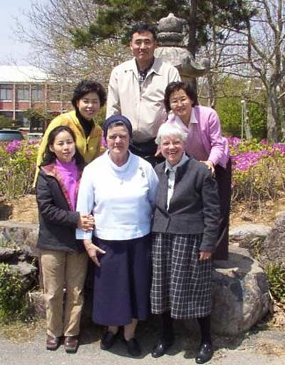 Sister Ann Patrick with other sisters and students in Korea