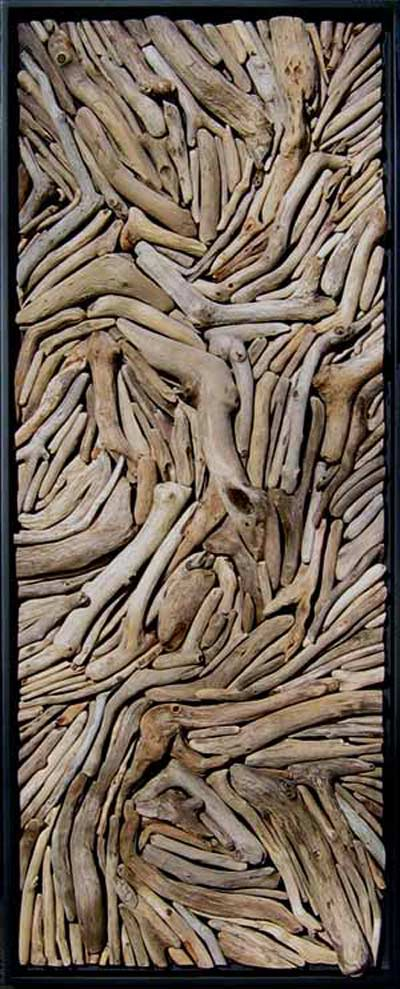 Susie Frazier Mueller Art work titled �Perseverance.� Driftwood mounted onto wood. No paint added.