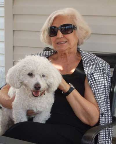 Virginia Marti with her Bichon Frise dog Sammy